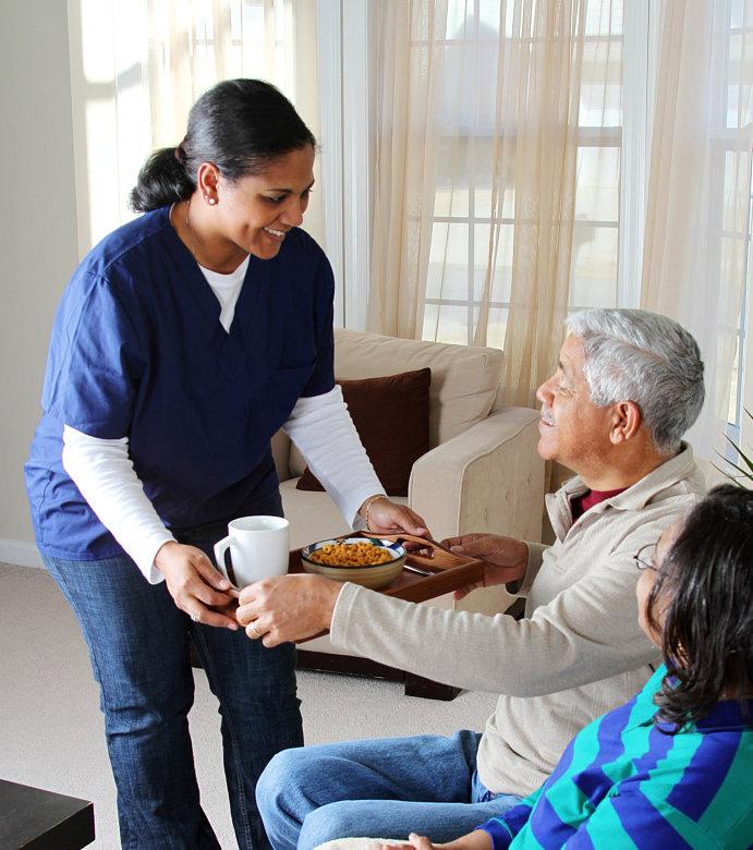 caregiver assisting seniors