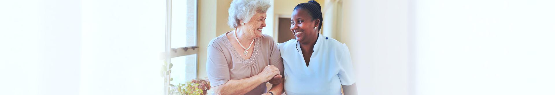 nurse and caregiver walking together