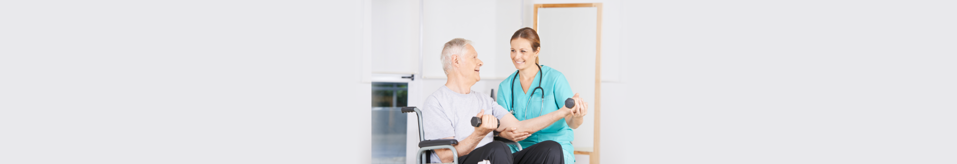 nurse helping senior man with his exercise